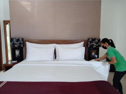 A bed or beds in a room at Grania Bali Villas