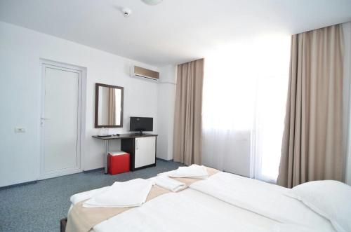 A bed or beds in a room at Babylonia Resort