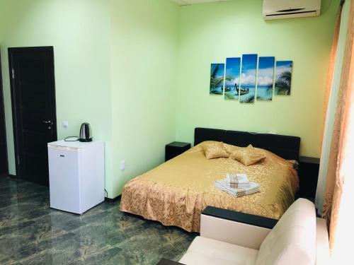 Кровать или кровати в номере Гостевой Дом Сан Бах