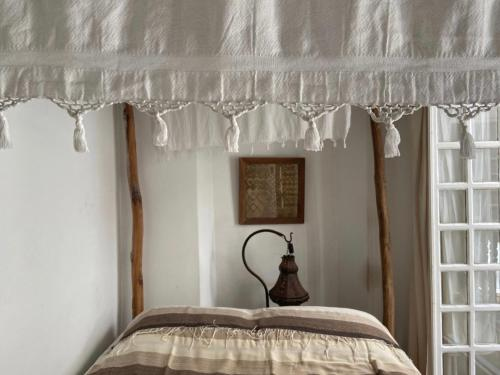 A bed or beds in a room at Riad Baladin