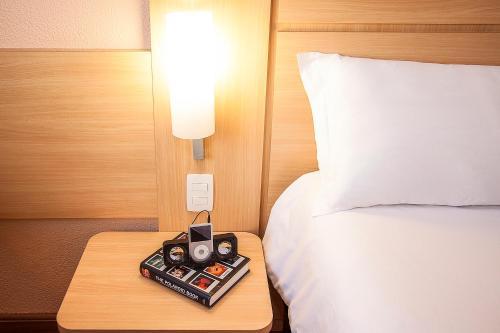Cama ou camas em um quarto em Ibis Sao Paulo Interlagos