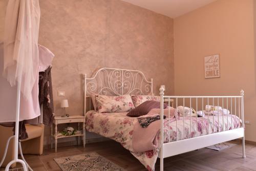 Letto o letti in una camera di Casa Nina
