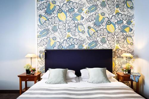 Ein Bett oder Betten in einem Zimmer der Unterkunft Hotel Goliath am Dom