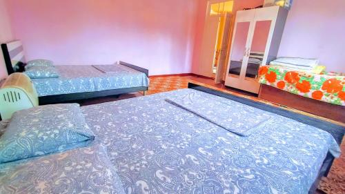 A bed or beds in a room at Guest House Ruslan