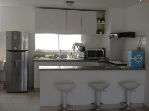 A kitchen or kitchenette at Asiasoleil