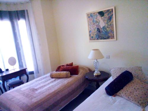 Ein Bett oder Betten in einem Zimmer der Unterkunft Vasari Village - Beach Aldea Hills