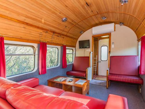 A seating area at Ohakune Train Stay - Carriage B