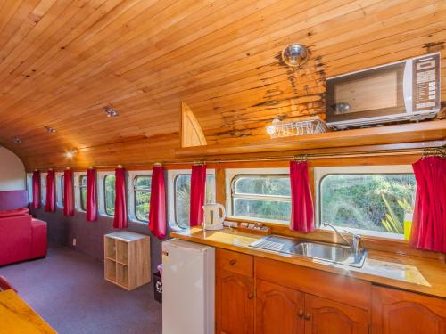 A kitchen or kitchenette at Ohakune Train Stay - Carriage B