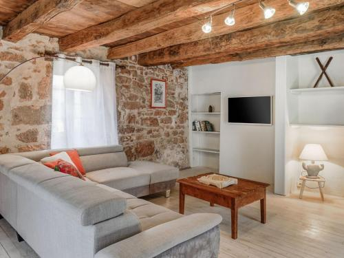 A seating area at Beautiful Holiday Home in Teillots France with Swimming Pool