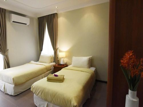 A bed or beds in a room at Tanjong Puteri Golf Resort Berhad