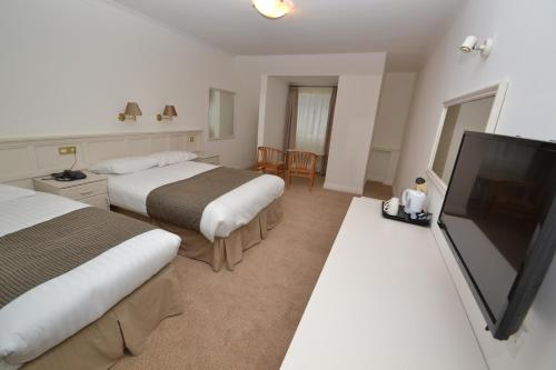 A bed or beds in a room at Bay View Hotel