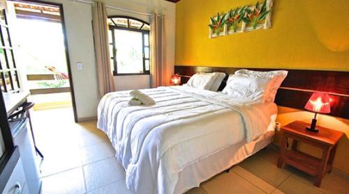 Cama o camas de una habitación en Pousada Rio Bracuhy