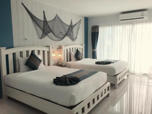 A bed or beds in a room at Ancora Blu Boutique Hotel B&B