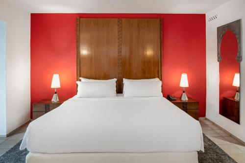 A bed or beds in a room at Le Meridien N'fis