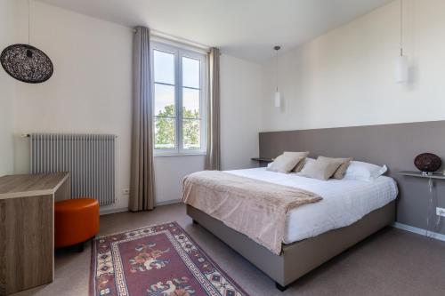 A bed or beds in a room at Villa Régina Trois-Épis