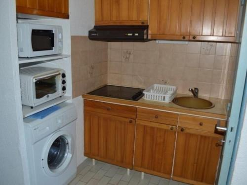 A kitchen or kitchenette at Apartment Copacabana