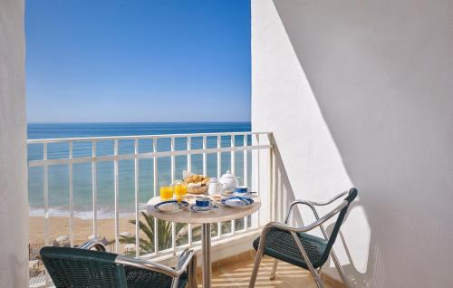 A balcony or terrace at Holiday Inn Algarve - Armação de Pêra, an IHG Hotel