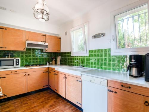 A kitchen or kitchenette at Cozy Holiday Home in Cogolin with Private Pool