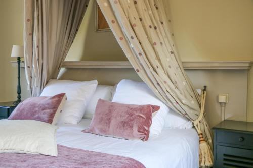 Ein Bett oder Betten in einem Zimmer der Unterkunft Auberge de Campveerse Toren