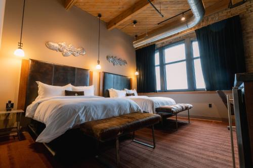 A bed or beds in a room at The Iron Horse Hotel