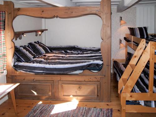 A bunk bed or bunk beds in a room at Chalet Rönninge by - STH280