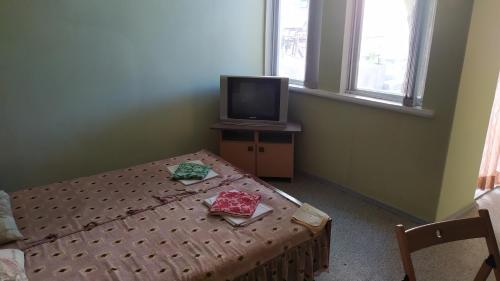 Кровать или кровати в номере Гостевой Дом Летний