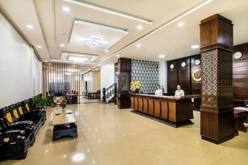 The lobby or reception area at Baly Hotel