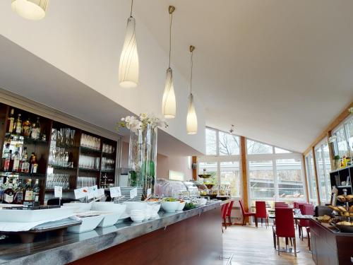 A restaurant or other place to eat at Hotel Via Roma