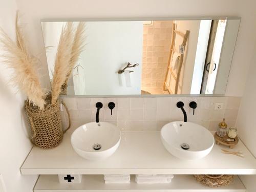 Een badkamer bij Aan huisje 49 - Houten Huisje