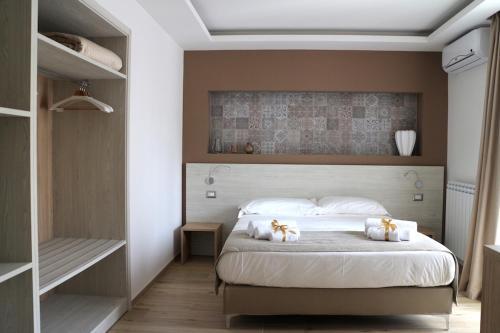 Letto o letti in una camera di Musmelia Rooms - Affittacamere