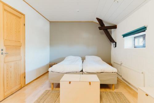 Vuode tai vuoteita majoituspaikassa Wiurila Guesthouse