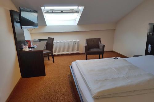 Ein Bett oder Betten in einem Zimmer der Unterkunft Stern