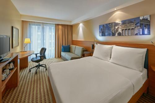 A bed or beds in a room at Hampton by Hilton Berlin City West