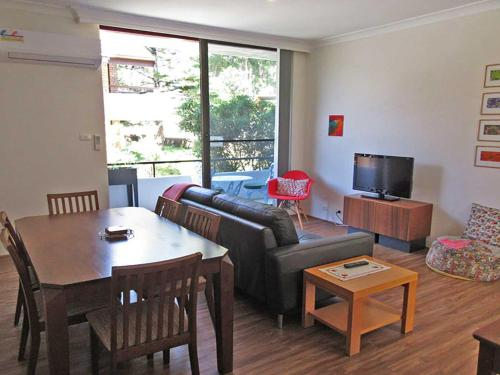 A seating area at 4 'Bellevue' 4 Donald Street - air conditioned apartment in the heart of Nelson Bay