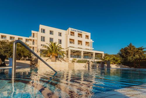The swimming pool at or near La Luna Hotel