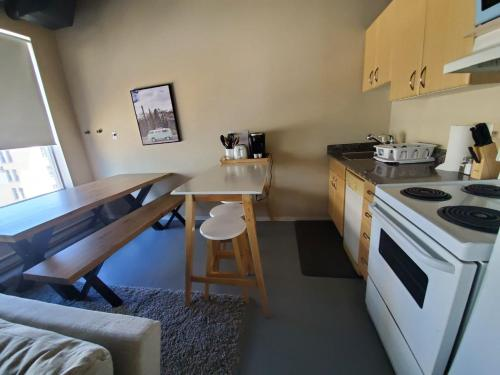 A kitchen or kitchenette at Modern DOWNTOWN Loft Near ROGERS PLACE,SHAW CONF