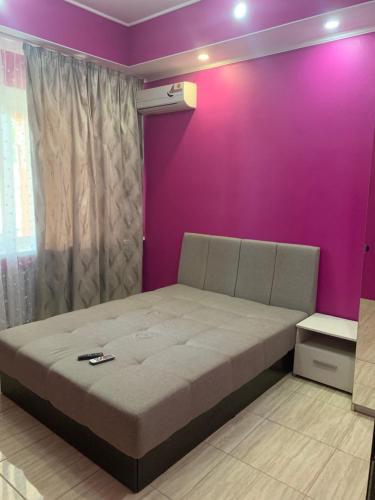 Кровать или кровати в номере Гостевой дом Диана