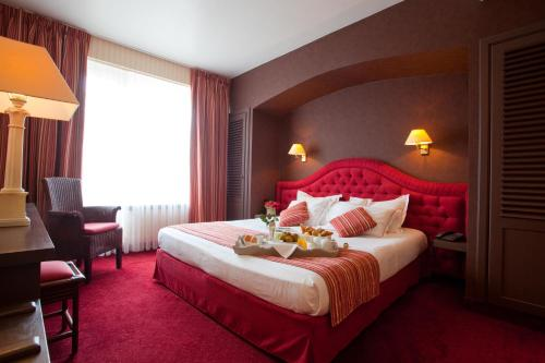 Un ou plusieurs lits dans un hébergement de l'établissement Hotel Imperial