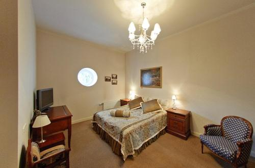 A bed or beds in a room at Malpils Manor