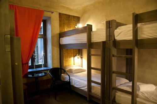 A bunk bed or bunk beds in a room at Two Wheels