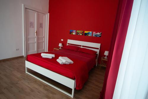 Un ou plusieurs lits dans un hébergement de l'établissement B&B Tarumbò