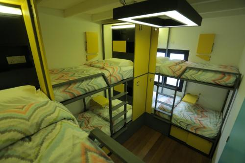 A bunk bed or bunk beds in a room at Nomaps Hotel