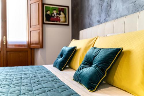Letto o letti in una camera di Marcus Suite