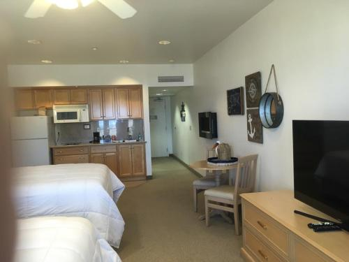 A television and/or entertainment center at Beach House Inn & Suites