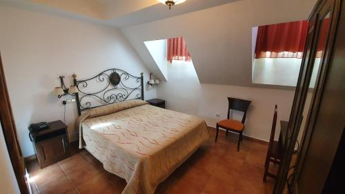 A bed or beds in a room at Coso Viejo