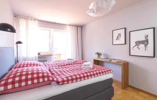 Ein Bett oder Betten in einem Zimmer der Unterkunft WÄLDER: Quartier Titisee