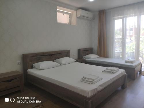 Кровать или кровати в номере Отель Бриз