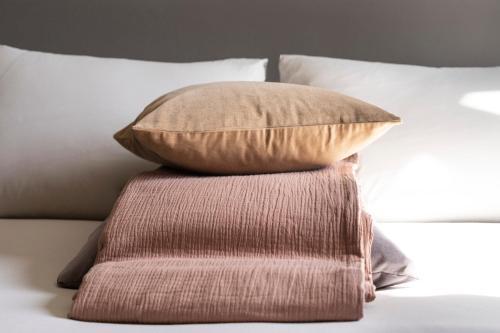 A bed or beds in a room at DestinationBCN Universitat Apartments