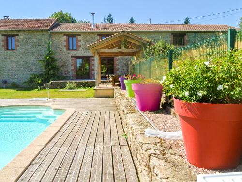 The swimming pool at or near Barn Holiday Home in Lavoine with Garden