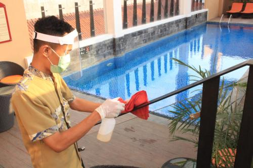 The swimming pool at or close to Hotel Chanti Managed by TENTREM Hotel Management Indonesia